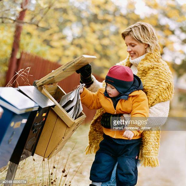 Woman and Child Holding Paper