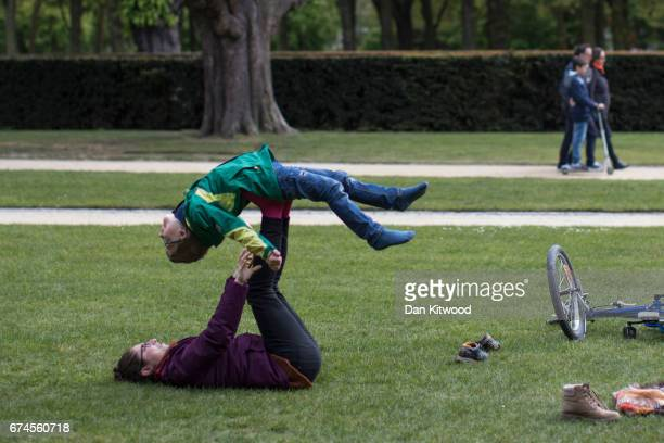 A woman and child play in a park on April 28 2017 in Brussels Belgium The 27 members of the European Union will meet in Brussels tomorrow for a...