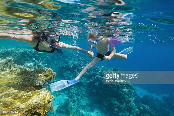 woman and child snorkeling