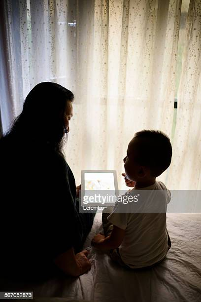 Woman and child using digital tablet