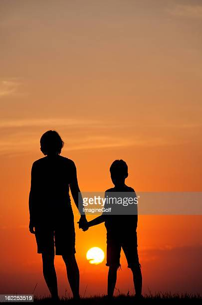 Woman and Child Watching Summer Sunset