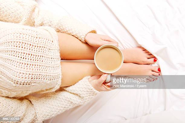 Woman And Coffee Cup On Bed