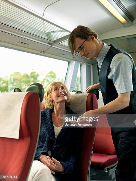 Woman and conductor on train