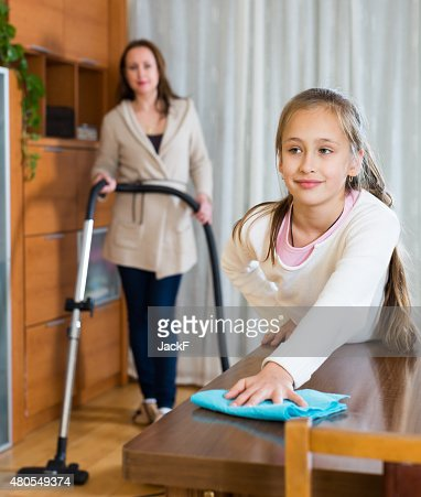 Woman and daughter cleans the house : Stock Photo