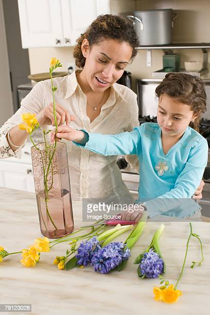 Woman and daughter with flowers