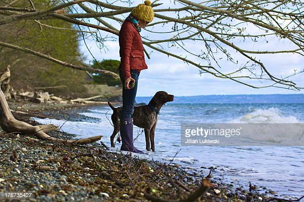 Woman and dog at the sea