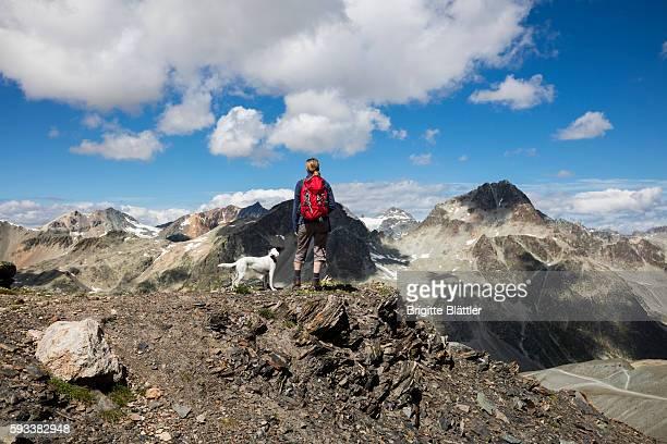 Woman and dog hiking at Piz Nair, Switzerland