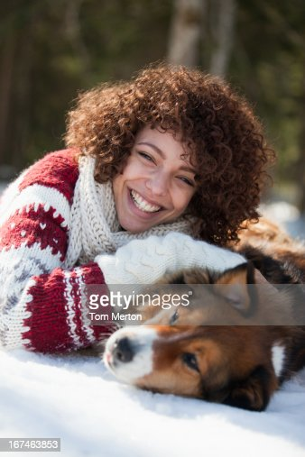 Woman and dog in snow : Stock Photo