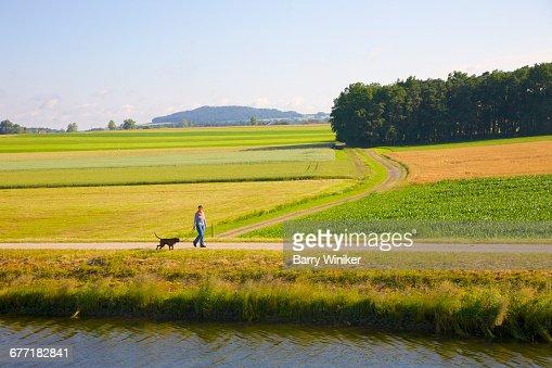 Woman and dog near Main River Bavaria, Germany
