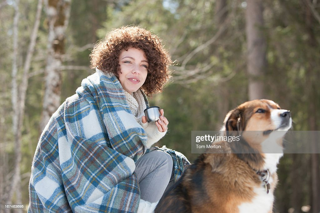 Woman and dog outdoors, winter : Stock Photo