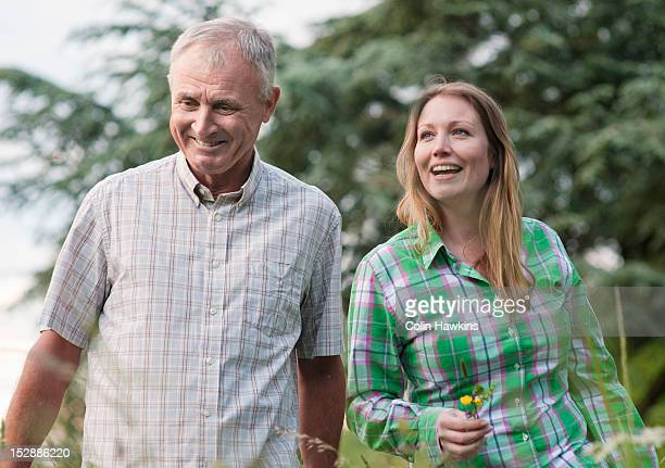 Woman and father walking outdoors