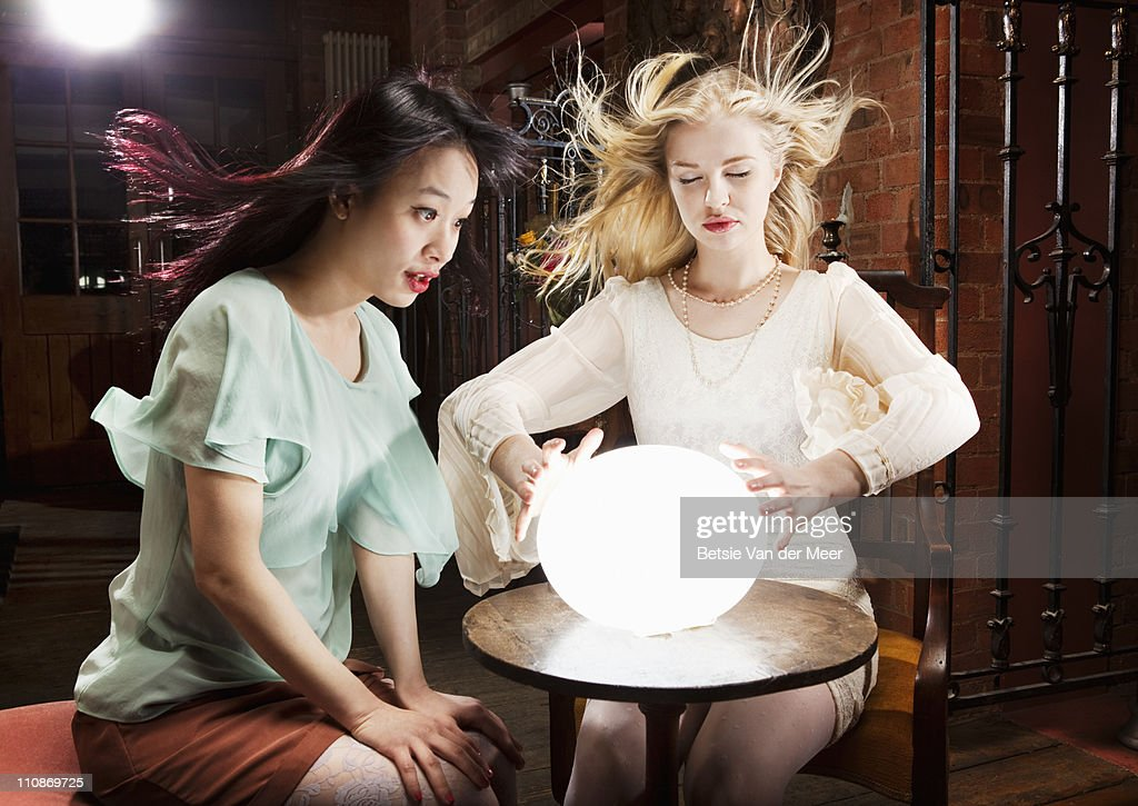 Woman and fortuneteller with crystal ball. : Stock-Foto