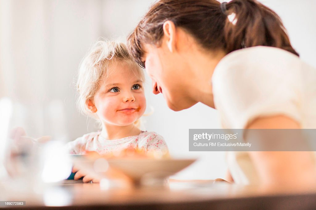 Woman and girl looking at each other