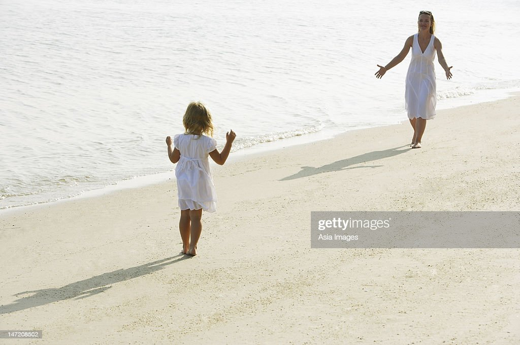 woman and girl on beach : Stock Photo