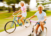 Woman and girl on bicycles