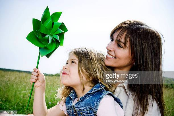 Woman and girl with toy windmill