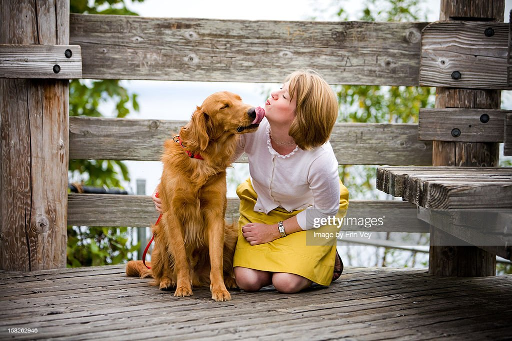 Woman and Golden Retriever : Stock Photo