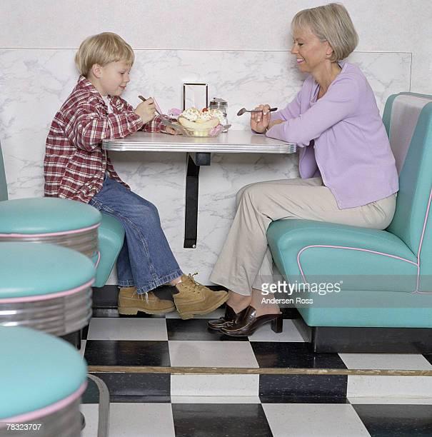 Woman and grandson sharing a banana split