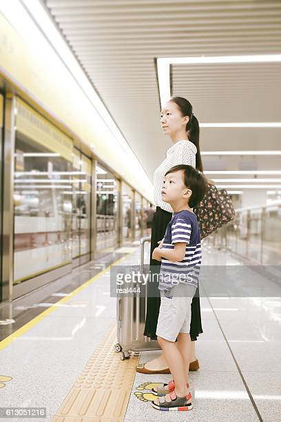 Woman and her child  waiting in the railway station
