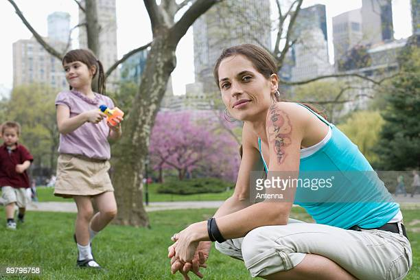 A woman and her children in Central Park, New York City