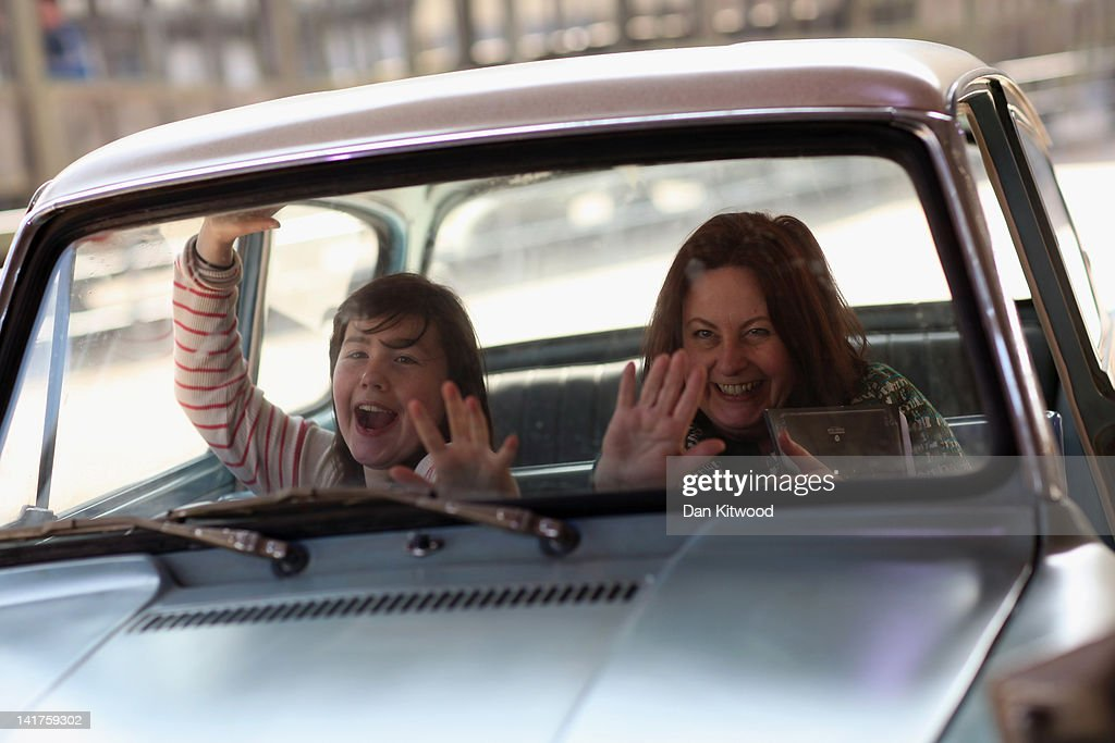 A woman and her daughter have their picture taken inside the Ford Anglia that was used in 'Harry Potter and the Chamber of Secrets' (the second film in the series) at the new Harry Potter Studio Tour at Warner Brothers Leavesden Studios on March 23, 2012 in London, England. The studio, which includes the actual sets and special effects departments where the films were created and shot, goes on public display on March 31, 2012.