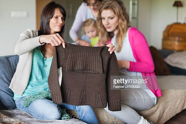 Woman and her daughter looking a sweater