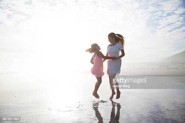 Woman and her daughter playing on beach