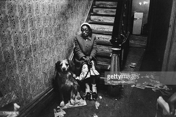 A woman and her dog on a staircase on the Lower East Side New York 1967