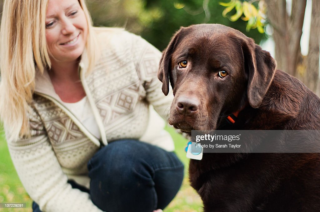Woman and her dog : Stock Photo