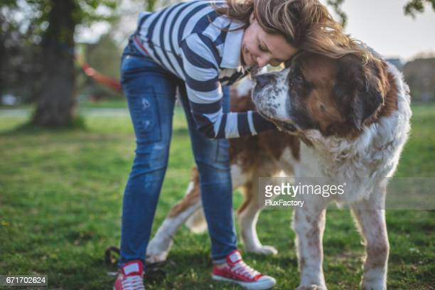 Woman and her dog, pressing forehead to forehead