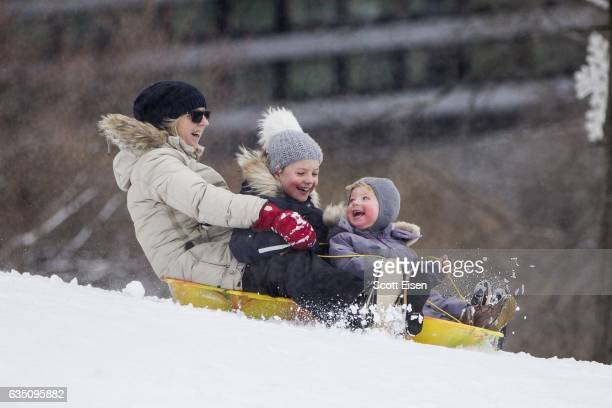 A woman and her grandchilden sled on Boston Common following a winter storm February 13 2017 in Boston Massachusetts Another winter storm has brought...