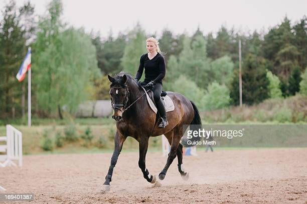 Woman and her horse doing dressage training