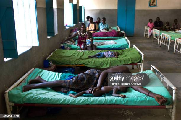 A woman and her malnourished baby sleep inside the feeding centre at the paediatric department of Malakal Teaching Hospital where ICRC doctor Giorgio...