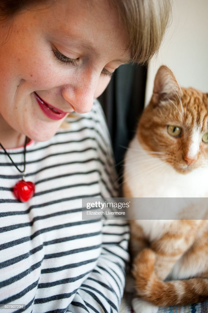 A woman and her pet cat