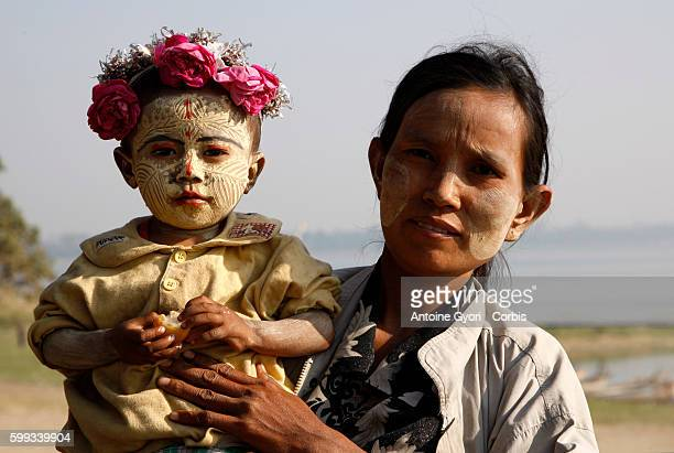 Woman and her son in the area of Mandalay Both have Thanaka on their face a bark paste that the locals use for protection from the sun and for clear...