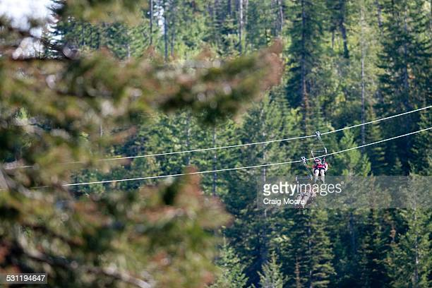A woman and her son on a zip line in Whitefish, Montana.