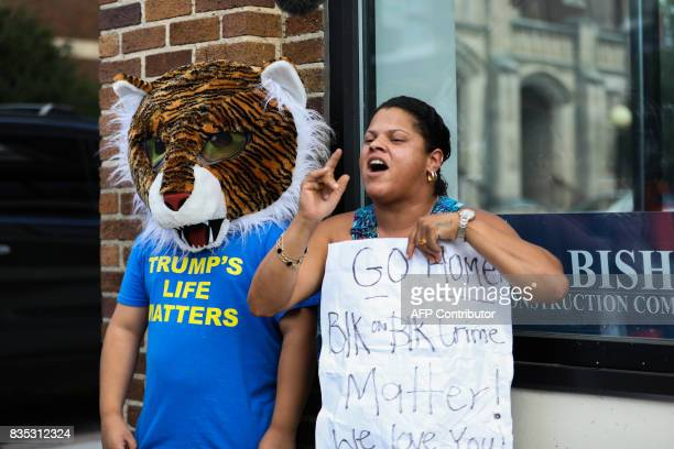 A woman and her son stand on a corner as counterprotesters of the demonstration celebrating the toppling of the Confederate Soldiers Monument in...