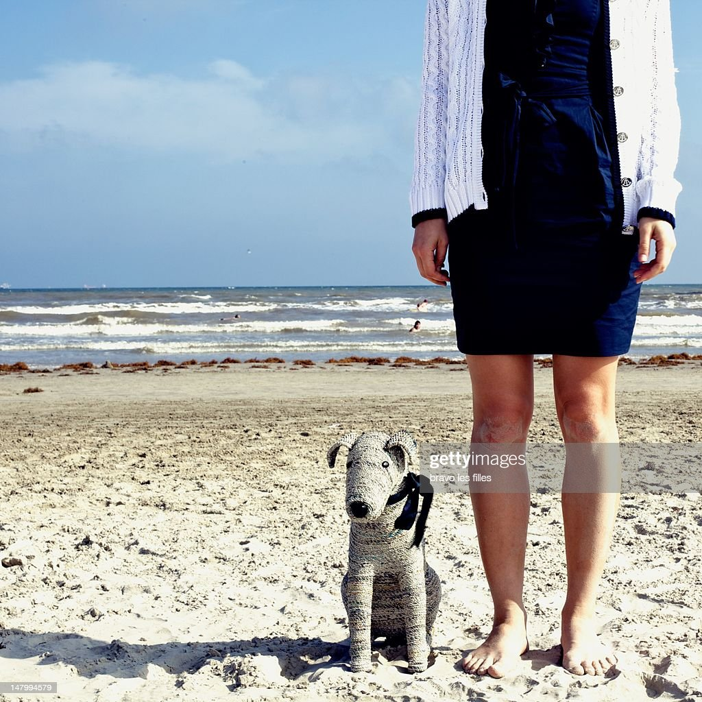 Woman and her toy dog Socrat on beach : Stock Photo