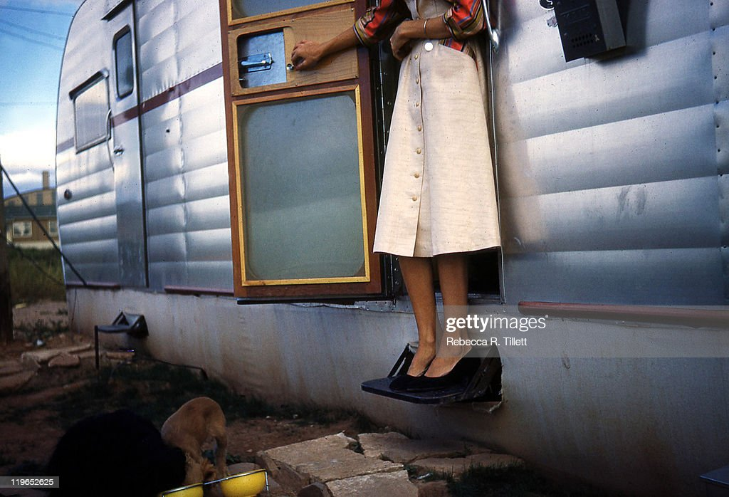 Woman and her two dogs beside motor home : Stock Photo