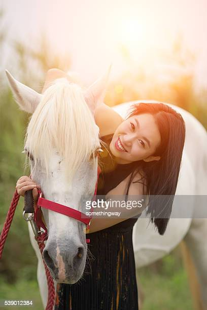 Woman and horse  in nature
