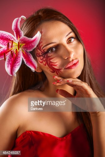 Woman and Lily : Stock Photo