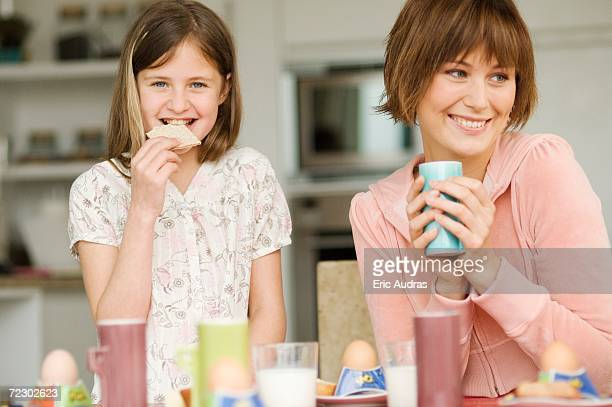 Woman and little girl at breakfast table
