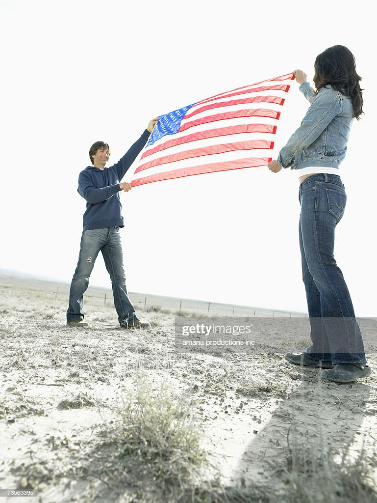 Woman and man holding Stars and Stripes