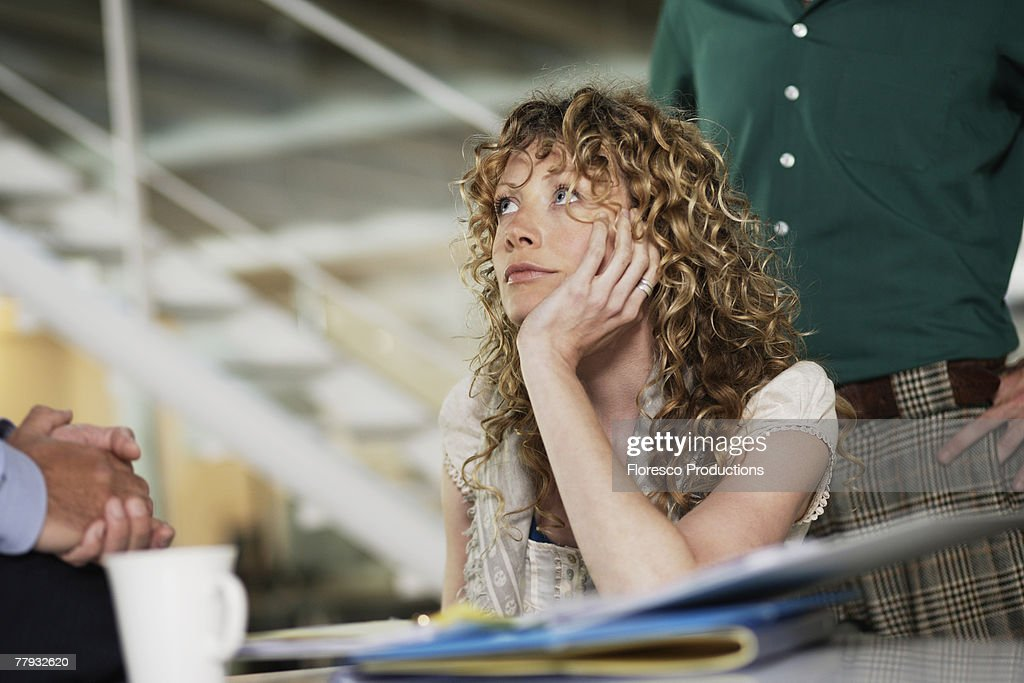 Woman and man in office with businessman : Stock Photo