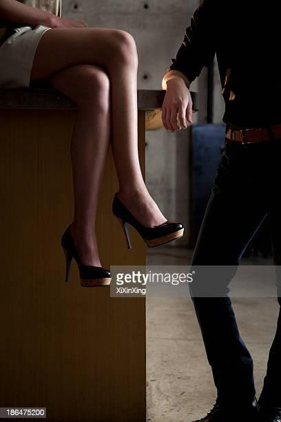 Woman and man next to bar counter