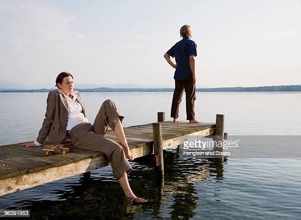 woman and man on pier at lake