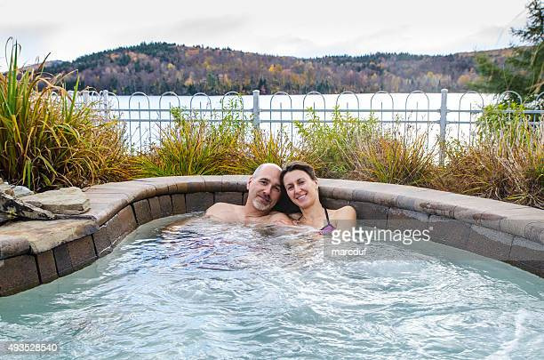 Woman and man relaxing in hot tub outside