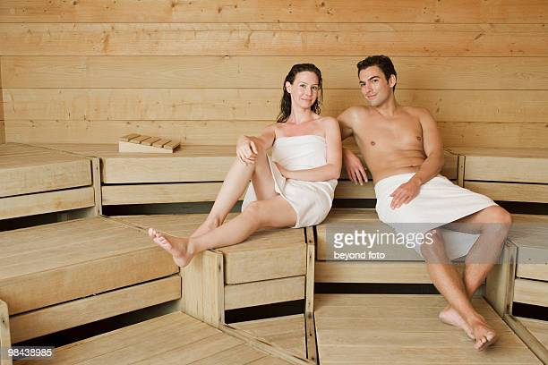 woman and man relaxing in sauna