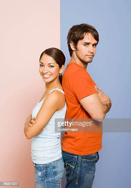 Woman and man standing back to back