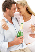 Woman and man with champagne bottle and glasses